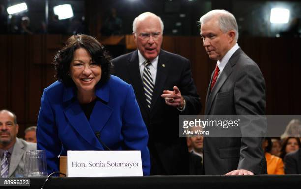 Supreme Court nominee Judge Sonia Sotomayor takes her seat with ranking member Sen Jeff Sessions and committee chairman Sen Patrick Leahy as she...