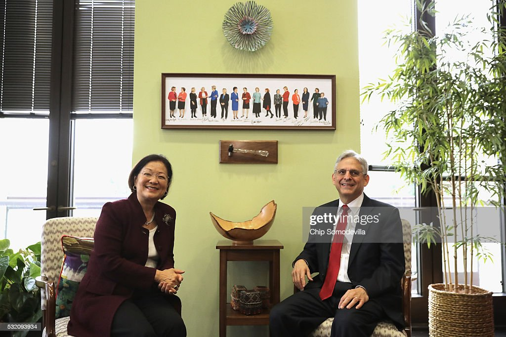 U.S. Supreme Court nominee <a gi-track='captionPersonalityLinkClicked' href=/galleries/search?phrase=Merrick+Garland&family=editorial&specificpeople=7549599 ng-click='$event.stopPropagation()'>Merrick Garland</a> (R) and Sen. <a gi-track='captionPersonalityLinkClicked' href=/galleries/search?phrase=Mazie+Hirono&family=editorial&specificpeople=3461717 ng-click='$event.stopPropagation()'>Mazie Hirono</a> (D-HI) pose for photographs before meeting in the Hart Senate Office Building on Capitol Hill May 18, 2016 in Washington, DC. Senate Republicans have so far refused to schedule a confirmation hearing for Garland, who was nominated by President Barack Obama to fill a vacancy on the court left when Associate Justice Antonin Scalia died earlier this year.