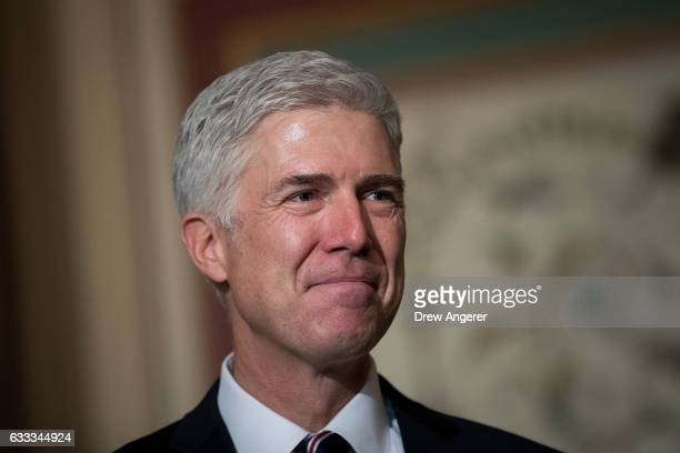 Supreme Court nominee Neil Gorsuch looks on as Senate Judiciary chairman Sen Chuck Grassley speaks to reporters before their meeting on Capitol Hill...