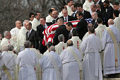 S Supreme Court Police pallbearers carry Associate Justice Antonin Scalia's flagcovered casket between rows of Catholic clergy and out of the...