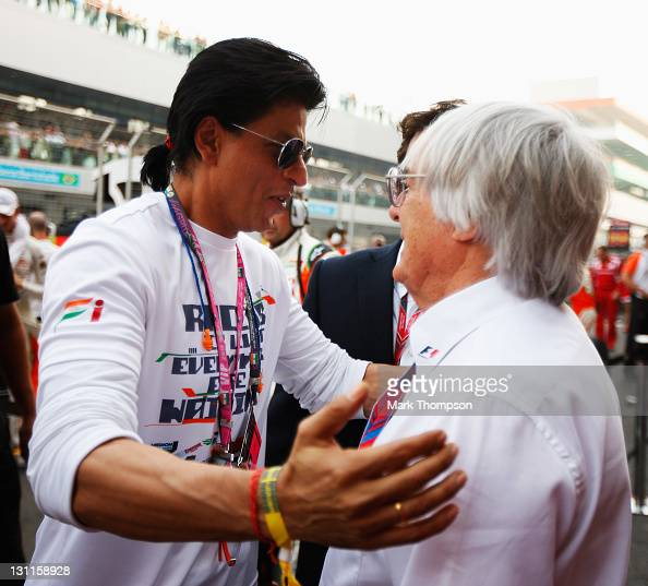 F1 supremo Bernie Ecclestone and Bollywood actor Shahrukh Khan are seen on the grid before the Indian Formula One Grand Prix at the Buddh...