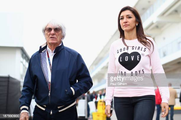 F1 supremo Bernie Ecclestone and his wife Fabiana Flosi arrive in the paddock during previews to the United States Formula One Grand Prix at Circuit...
