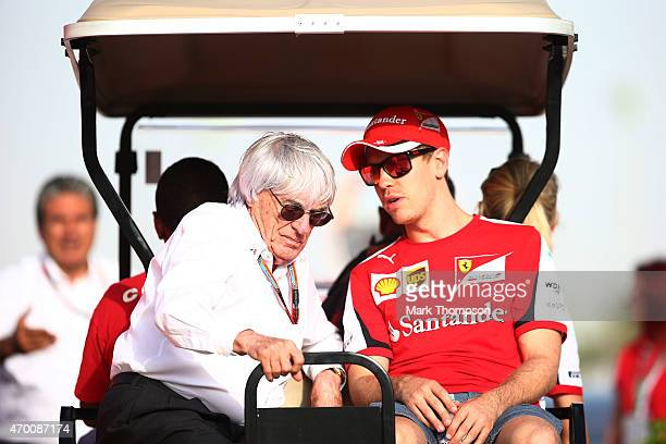 F1 supremo Bernie Ecclestone chats with Sebastian Vettel of Germany and Ferrari during practice for the Bahrain Formula One Grand Prix at Bahrain...