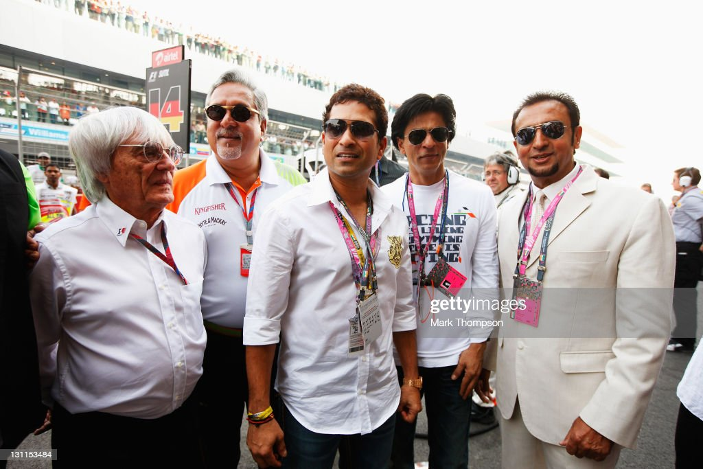 F1 supremo Bernie Ecclestone Force India Chairman Vijay Mallya cricketer Sachin Tendulkar and Bollywood actors Shahrukh Khan and Gulshan Grover are...