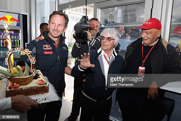 F1 supremo Bernie Ecclestone is presented with a birthday cake at Red Bull Racing hospitality by Red Bull Racing Team Principal Christian Horner...