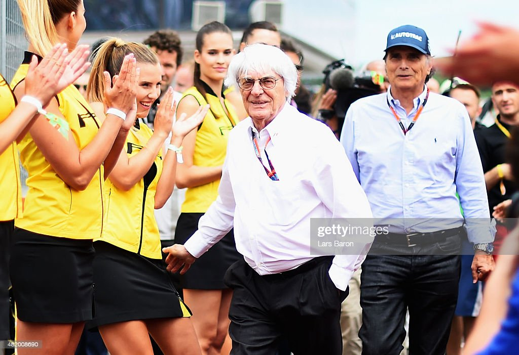 F1 supremo <a gi-track='captionPersonalityLinkClicked' href=/galleries/search?phrase=Bernie+Ecclestone&family=editorial&specificpeople=211579 ng-click='$event.stopPropagation()'>Bernie Ecclestone</a> jokes with a grid girl during the drivers' parade before the Formula One Grand Prix of Hungary at Hungaroring on July 26, 2015 in Budapest, Hungary.