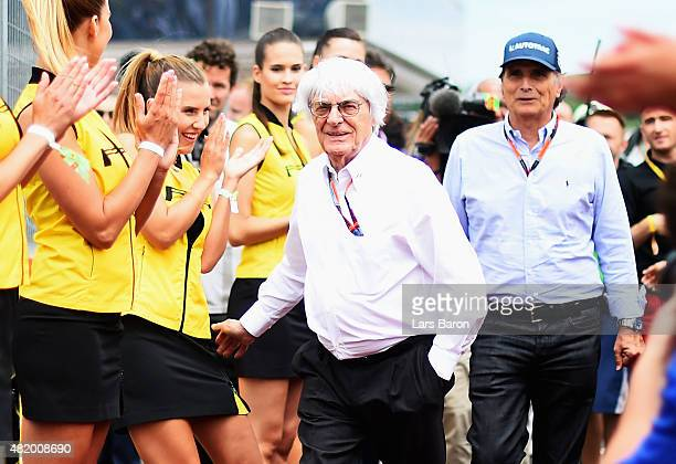 F1 supremo Bernie Ecclestone jokes with a grid girl during the drivers' parade before the Formula One Grand Prix of Hungary at Hungaroring on July 26...