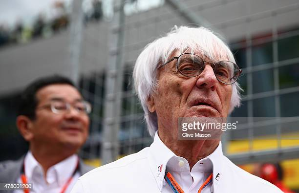 F1 supremo Bernie Ecclestone looks on as he waits on the grid before the Formula One Grand Prix of Austria at Red Bull Ring on June 21 2015 in...