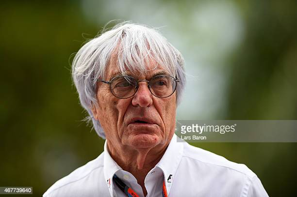 F1 supremo Bernie Ecclestone looks on in the paddock after practice for the Malaysia Formula One Grand Prix at Sepang Circuit on March 27 2015 in...