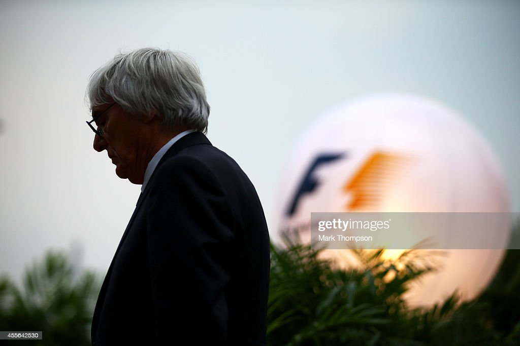 F1 supremo Bernie Ecclestone looks on in the paddock during previews ahead of the Singapore Formula One Grand Prix at Marina Bay Street Circuit on...