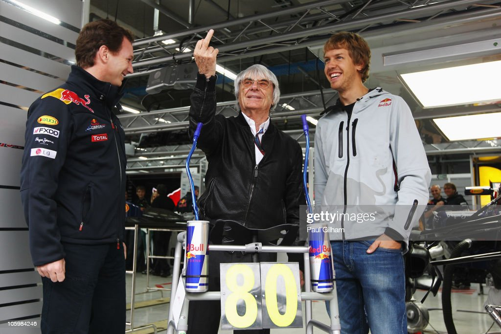 F1 supremo <a gi-track='captionPersonalityLinkClicked' href=/galleries/search?phrase=Bernie+Ecclestone&family=editorial&specificpeople=211579 ng-click='$event.stopPropagation()'>Bernie Ecclestone</a> (C) reacts as <a gi-track='captionPersonalityLinkClicked' href=/galleries/search?phrase=Christian+Horner&family=editorial&specificpeople=228706 ng-click='$event.stopPropagation()'>Christian Horner</a> (L), <a gi-track='captionPersonalityLinkClicked' href=/galleries/search?phrase=Sebastian+Vettel&family=editorial&specificpeople=2233605 ng-click='$event.stopPropagation()'>Sebastian Vettel</a> (R) and the Red Bull Racing team present him with a specially made zimmer frame to celebrate his 80th birthday before the Korean Formula One Grand Prix at the Korea International Circuit on October 24, 2010 in Yeongam-gun, South Korea.