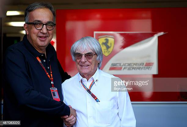 F1 supremo Bernie Ecclestone shakes hands with Fiat CEO Sergio Marchionne outside the team hospitality unit before the Formula One Grand Prix of...