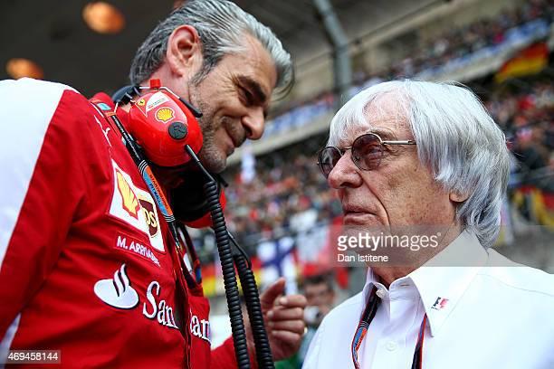 F1 supremo Bernie Ecclestone speaks with Ferrari Team Principal Maurizio Arrivabene on the grid before the Formula One Grand Prix of China at...