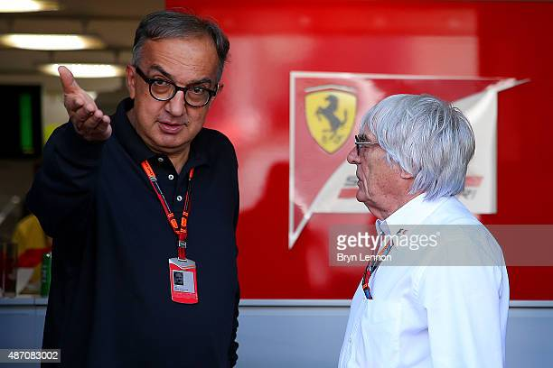 F1 supremo Bernie Ecclestone speaks with Fiat CEO Sergio Marchionne outside the team hospitality unit before the Formula One Grand Prix of Italy at...