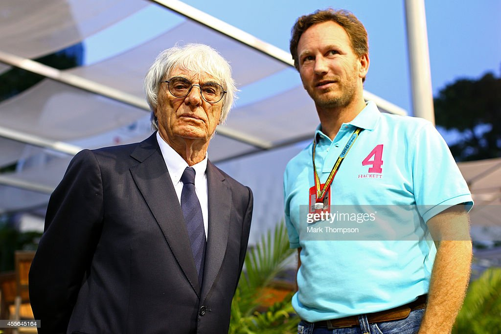 F1 supremo Bernie Ecclestone speaks with Infiniti Red Bull Racing Team Principal Christian Horner in the paddock during previews ahead of the...