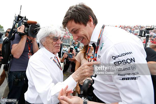 F1 supremo Bernie Ecclestone speaks with Mercedes GP Executive Director Toto Wolff during the Canadian Formula One Grand Prix at Circuit Gilles...