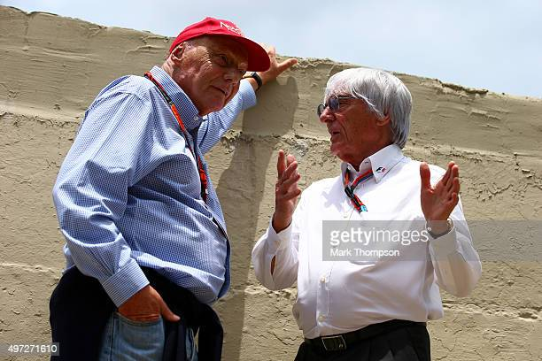 F1 supremo Bernie Ecclestone speaks with Mercedes GP nonexecutive chairman Niki Lauda on the grid before the Formula One Grand Prix of Brazil at...