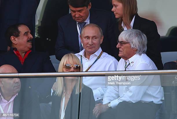 F1 supremo Bernie Ecclestone speaks with Russian Resident Vladimir Putin during the Russian Formula One Grand Prix at Sochi Autodrom on October 12...