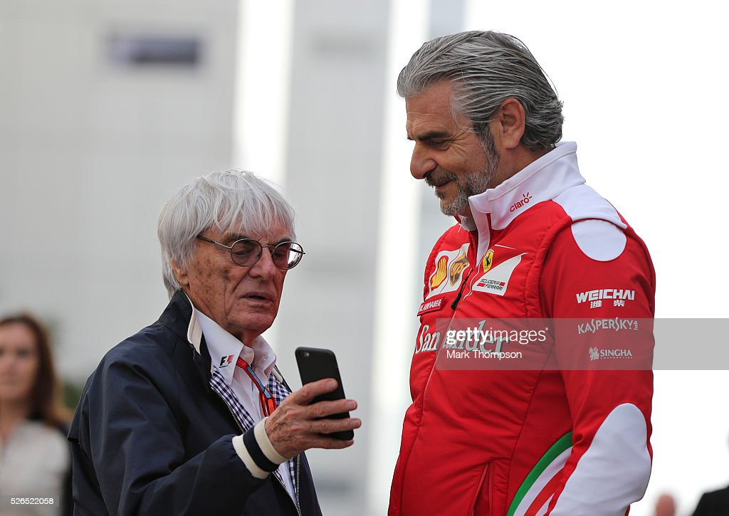 F1 supremo Bernie Ecclestone talks to Ferrari Team Principal Maurizio Arrivabene in the Paddock during qualifying for the Formula One Grand Prix of Russia at Sochi Autodrom on April 30, 2016 in Sochi, Russia.