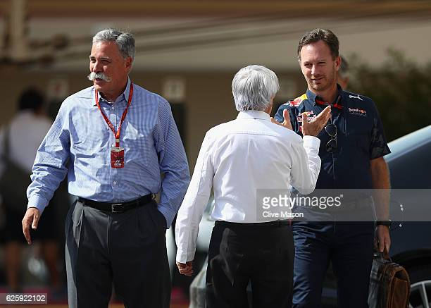 F1 supremo Bernie Ecclestone talks with Chase Carey Chairman of Formula One Group and Red Bull Racing Team Principal Christian Horner in the Paddock...