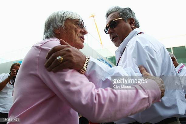 F1 supremo Bernie Ecclestone talks with Force India Chairman Vijay Mallya in the paddock during previews to the Indian Formula One Grand Prix at the...