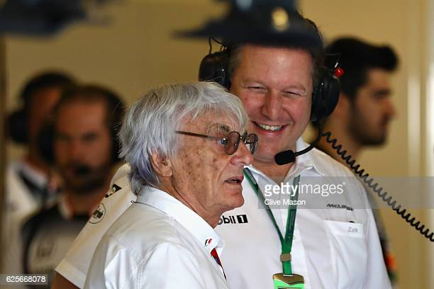F1 supremo Bernie Ecclestone talks with McLaren Executive Director Zak Brown in the garage during practice for the Abu Dhabi Formula One Grand Prix...