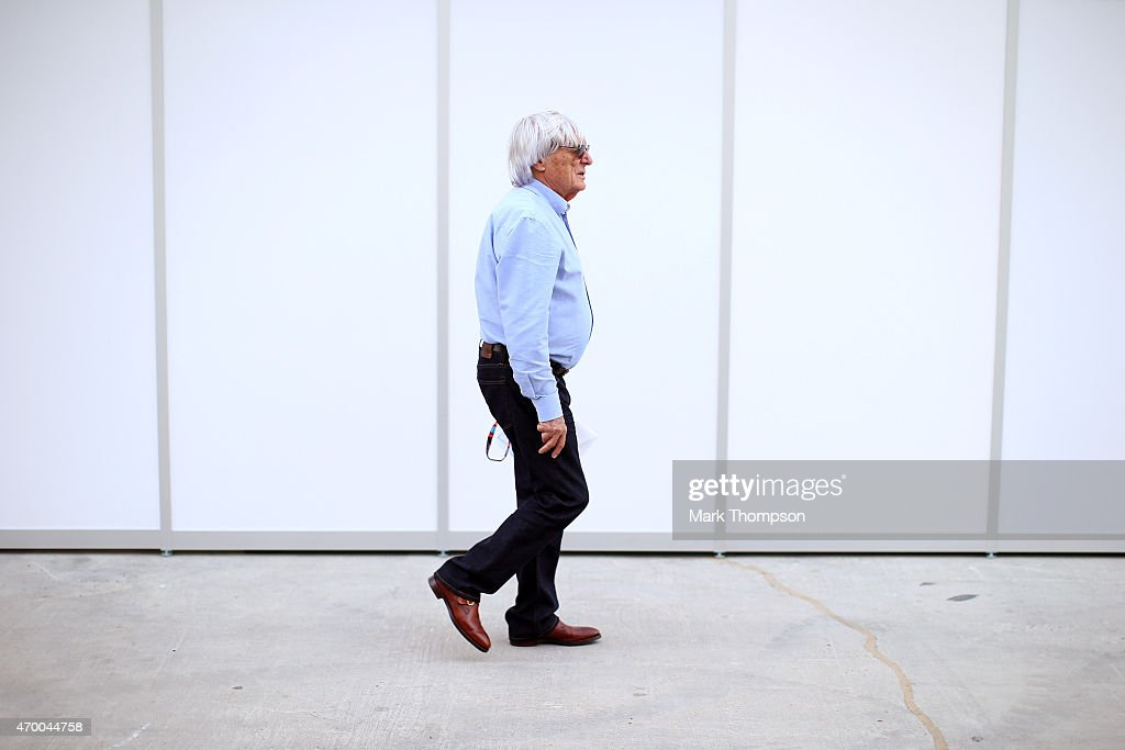 F1 supremo Bernie Ecclestone walks across the paddock during previews to the Bahrain Formula One Grand Prix at Bahrain International Circuit on April...