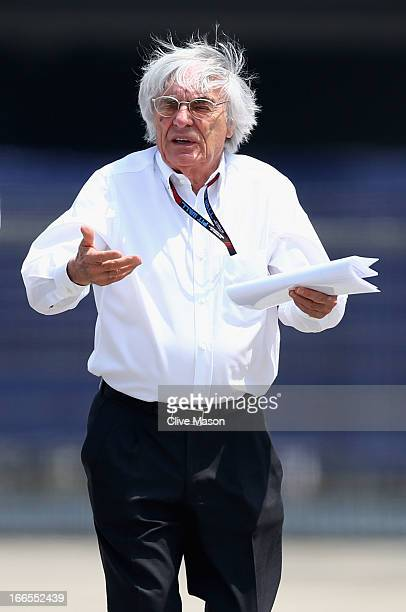 F1 supremo Bernie Ecclestone walks in the paddock before the Chinese Formula One Grand Prix at the Shanghai International Circuit on April 14 2013 in...