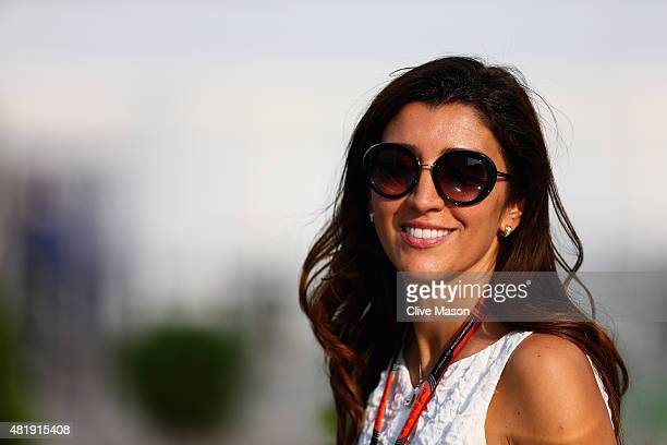 F1 supremo Bernie Ecclestone's wife Fabiana Flosi leaves the paddock after qualifying for the Formula One Grand Prix of Hungary at Hungaroring on...