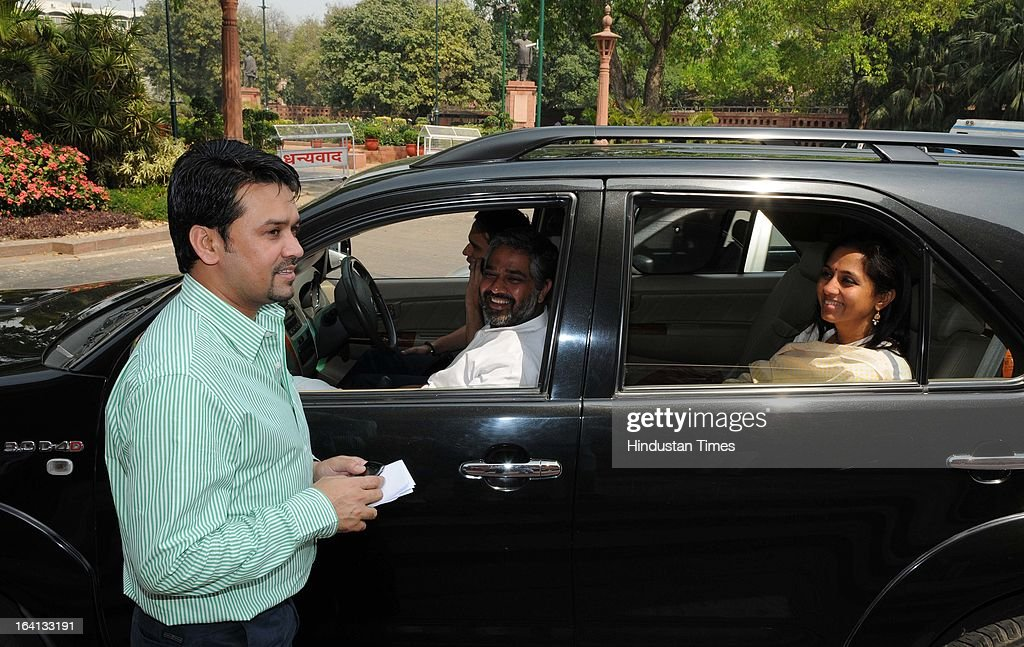 Supriya Sule ( R) and Neeraj Shekhar ( 2 L) talking with BJP Leader Anurag Thakur (L) at the Parliament House after attending Parliament Budget Session on March 20, 2013 in New Delhi, India.