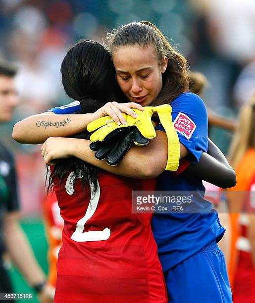 Sura Yekka of Canada hugs goalkeeper Kailen Sheridan of Canada after their 20 loss to Germany in the FIFA U20 Women's World Cup Canada 2014 Quarter...