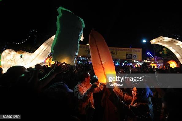 Surabaya Major Tri Risma Harini releases a paper lantern during Moon Cake Festival at Sanggar Agung Temple Kenjeran on September 15 2016 in Surabaya...