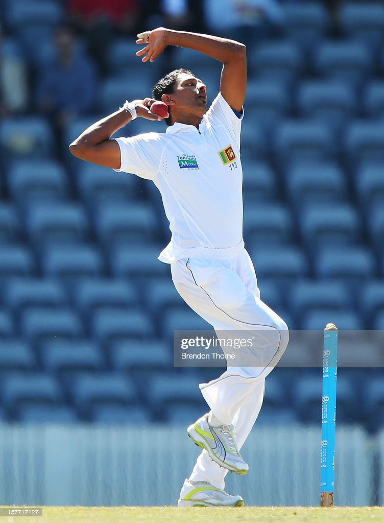 Suraj Randiv of Sri Lanka bowls during day one of the international tour match between the Chairman's XI and Sri Lanka at Manuka Oval on December 6, 2012 in Canberra, Australia.