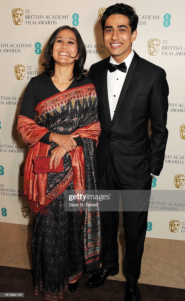 <a gi-track='captionPersonalityLinkClicked' href=/galleries/search?phrase=Suraj+Sharma&family=editorial&specificpeople=9768453 ng-click='$event.stopPropagation()'>Suraj Sharma</a> (R) arrives at the EE British Academy Film Awards at the Royal Opera House on February 10, 2013 in London, England.