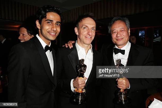 Suraj Sharma Mychael Danna and Ang Lee attend the 2013 Vanity Fair Oscar Party hosted by Graydon Carter at Sunset Tower on February 24 2013 in West...