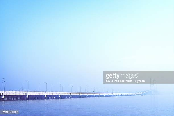 Suramadu Bridge Over Sea Against Blue Sky