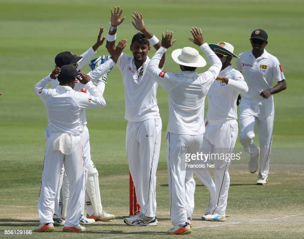 Suranga Lakmal of Sri Lanka celebrate with teammates after dismissing Sarfraz Ahmed of Pakistan during Day Four of the First Test between Pakistan...