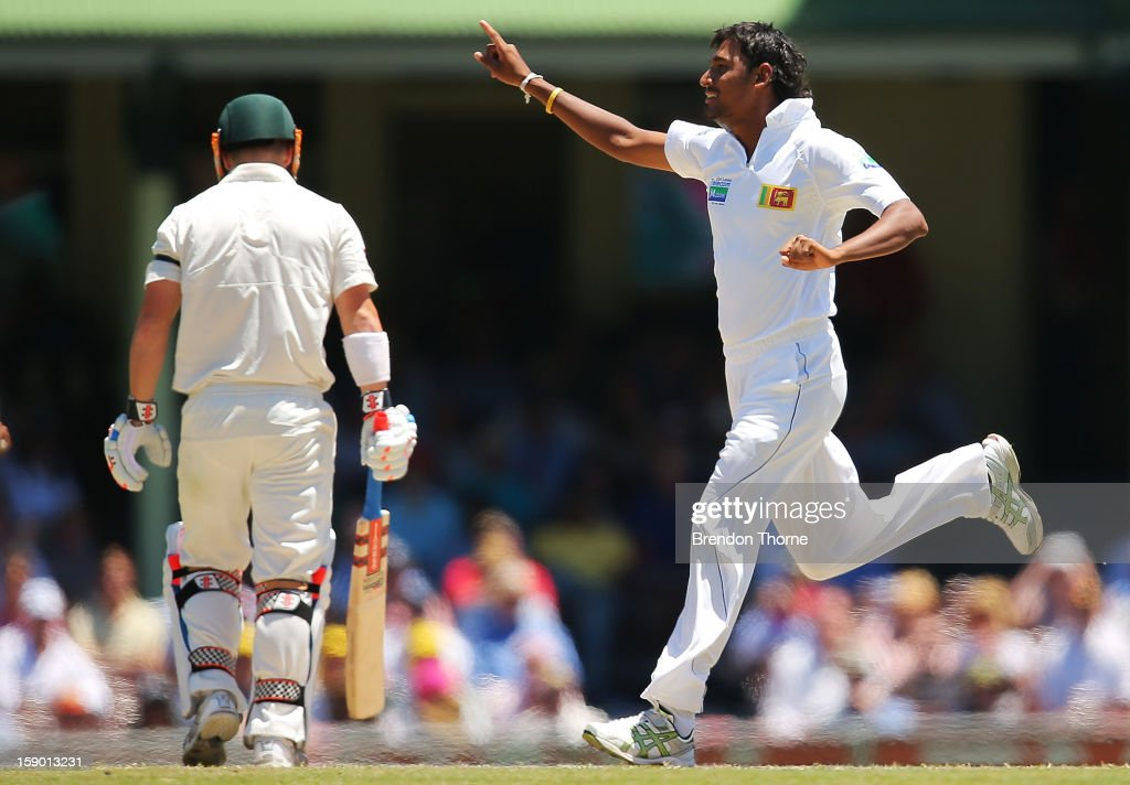 Suranga Lakmal of Sri Lanka celebrates after claiming the wicket of David Warner of Australia during day four of the Third Test match between Australia and Sri Lanka at the Sydney Cricket Ground on January 6, 2013 in Sydney, Australia.