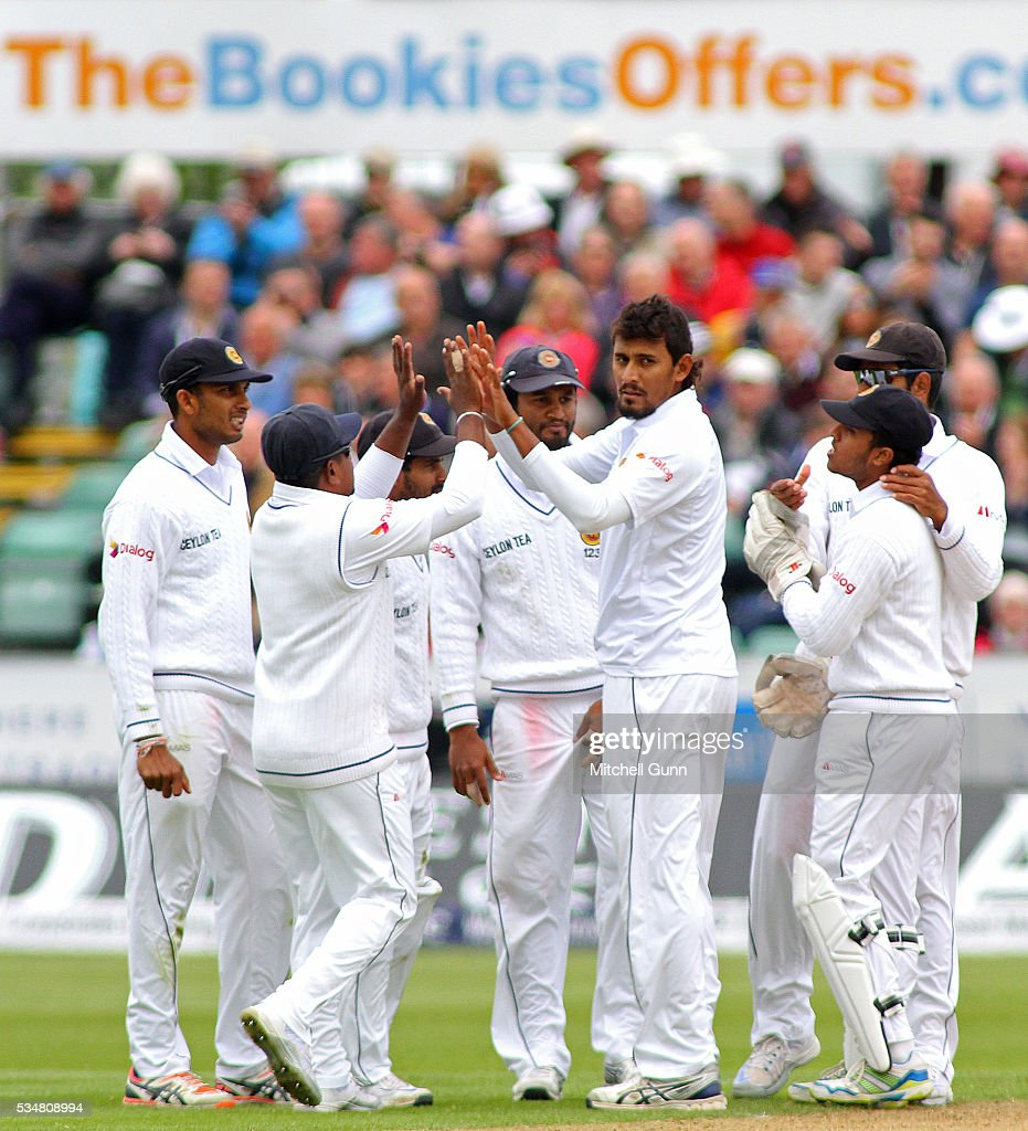 <a gi-track='captionPersonalityLinkClicked' href=/galleries/search?phrase=Suranga+Lakmal&family=editorial&specificpeople=5742345 ng-click='$event.stopPropagation()'>Suranga Lakmal</a> of Sri Lanka celebrates taking the wicket of Chris Woakes of England during day two of the 2nd Investec Test match between England and Sri Lanka at Emirates Durham ICG on May 28, 2016 in Chester-le-Street, United Kingdom.