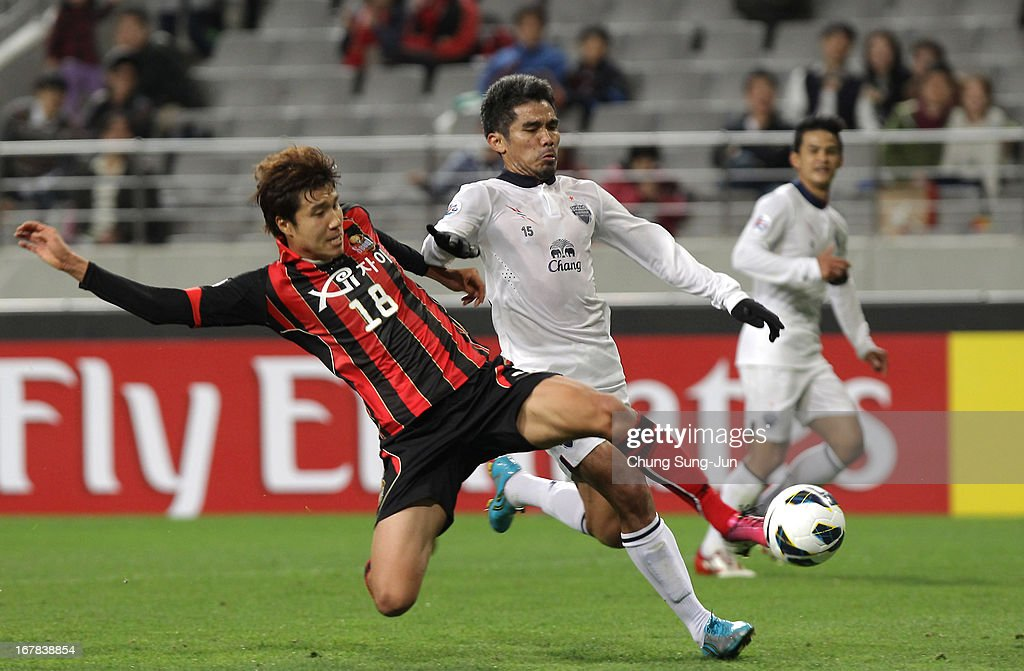 Surat Sukha of Buriram United tussles for possession with Kim Hyun-Sung of FC Seoul during the AFC Champions League Group E match between FC Seoul and Buriram United at Seoul World Cup Stadium on May 1, 2013 in Seoul, South Korea.