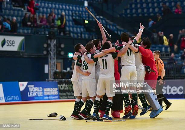 Surbiton players celebrate the win at the end of the Maxifuel Super Sixes Mens Final match between Surbiton and East Grinstead at Wembley Arena on...