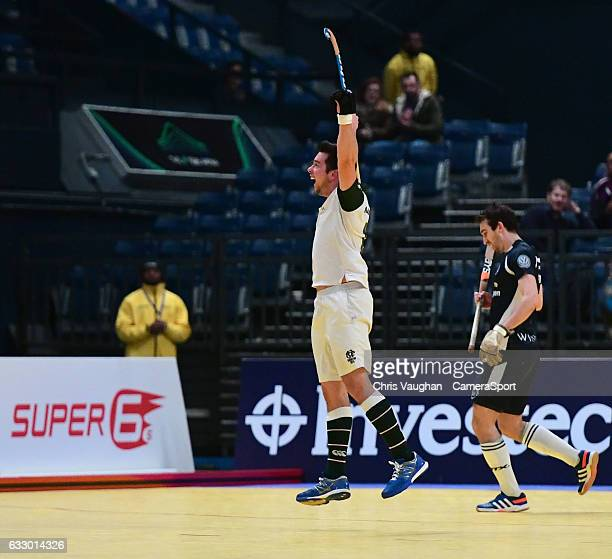 Surbiton's David Beckett celebrates scoring his sides fifth goal during the Maxifuel Super Sixes Mens Final match between Surbiton and East Grinstead...
