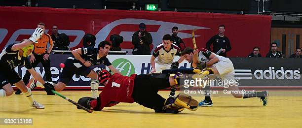 Surbiton's David Beckett scores his sides second goal during the Maxifuel Super Sixes Mens Final match between Surbiton and East Grinstead at Wembley...