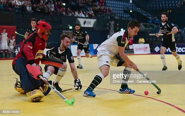 Surbiton's Rob Farrington scores his sides third goal during the Maxifuel Super Sixes Mens Final match between Surbiton and East Grinstead at Wembley...
