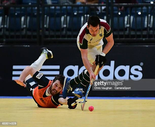 Surbiton's William Marshall vies for possession with East Grinstead's Adam Seccull during the Maxifuel Super Sixes Mens Final match between Surbiton...