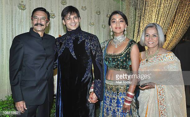 Suresh Oberoi with son Vivek daughterinlaw Priyanka and wife Yashodhara during the actor's wedding reception in Mumbai on October 31 2010