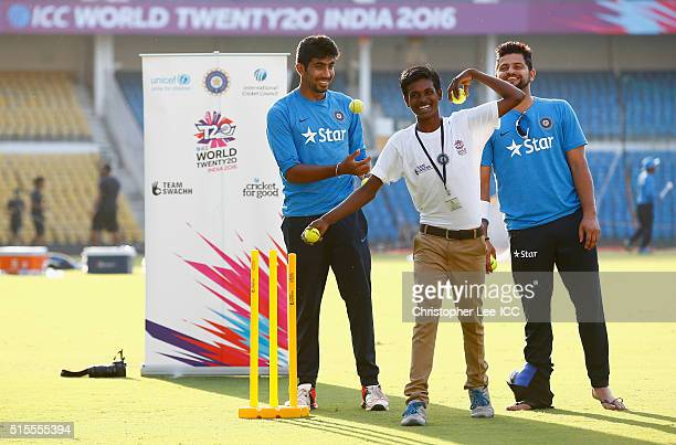 Suresh Raina and Jasprit Bumrah of India take part in a game of cricket with local kids during the ICC Cricket For Good and Team Swachh cricket...