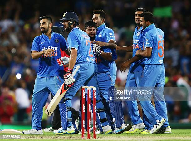 Suresh Raina and Yuvraj Singh of India celebrate hitting the winning runs on the last ball of the match with team mates during the International...