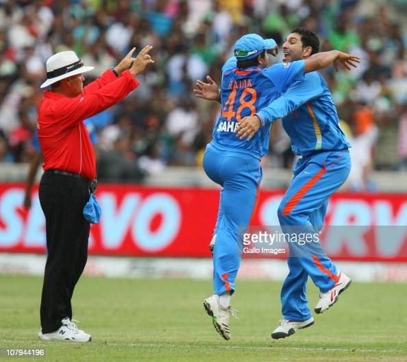 Suresh Raina and Yuvraj Singh of India celebrate the wicket of AB de Villiers of South Africa during the Standard Bank Pro20 international match...