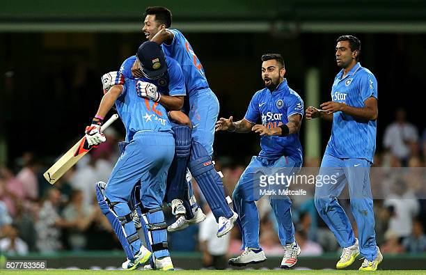 Suresh Raina and Yuvraj Singh of India celebrate victory with team mates in the International Twenty20 match between Australia and India at Sydney...